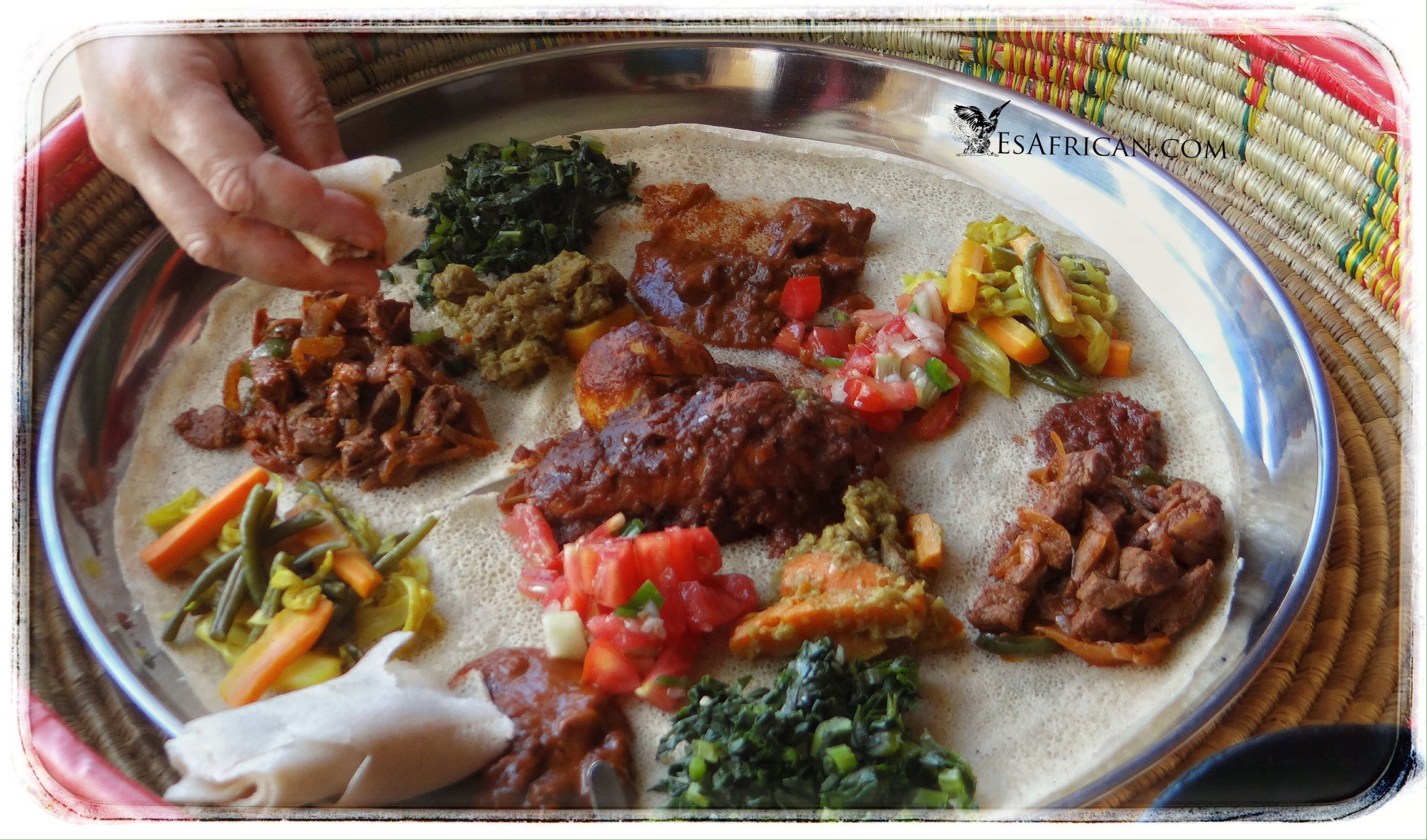 Delicious Ethiopian food is place on the injera within the moseb basket