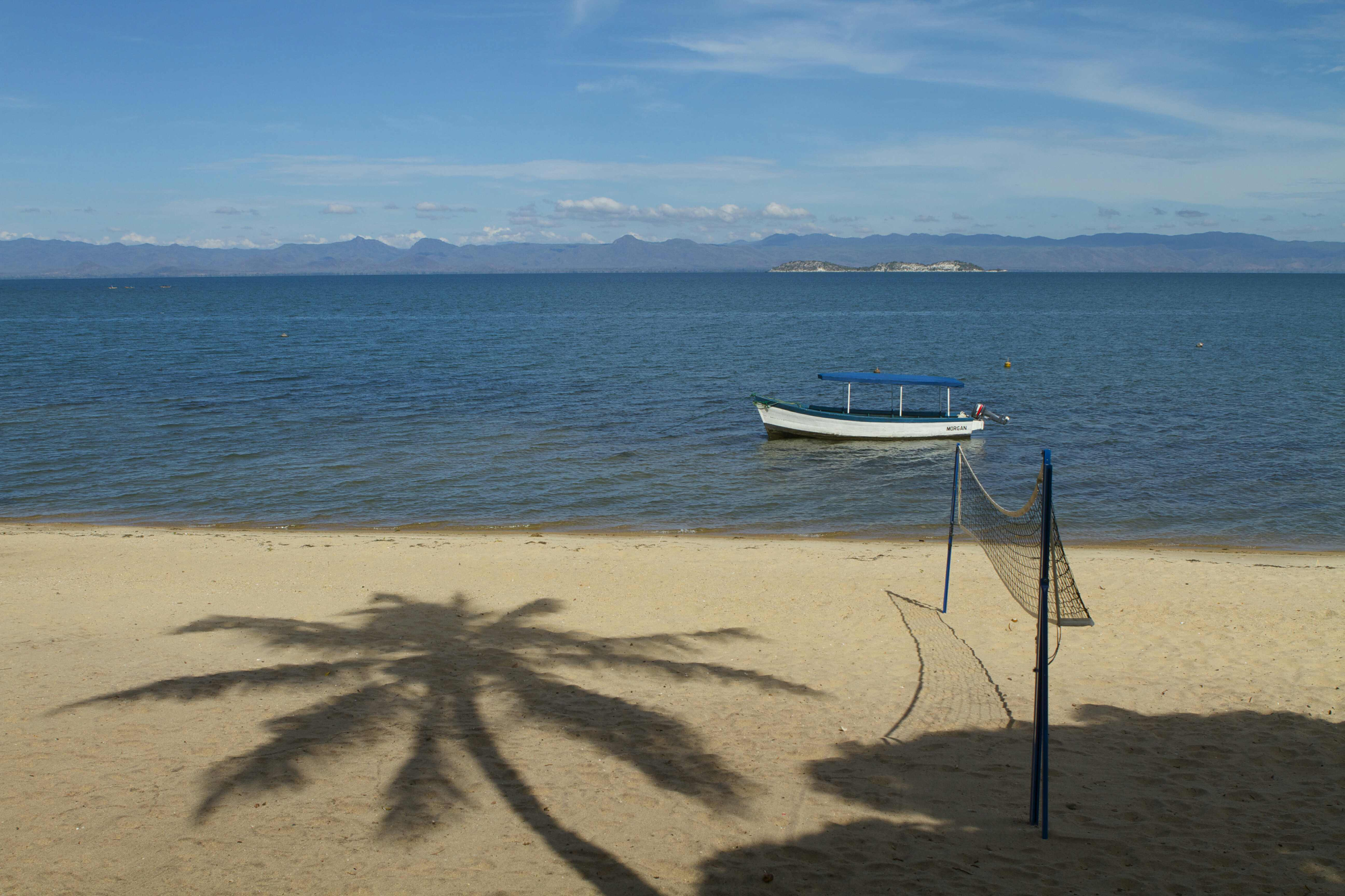 Where is the ideal location for enjoying the blue lake, the golden sands and the blue skies of Lake Malawi?